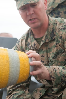 Staff Sgt. Sean Obrien,a Marine Aviation Logistics Squadron 13 Operations Chief based at Marine Corps Air Station Yuma, Ariz. and native of Glen Ellyn, Ill. teaches Marines how to quickly put together a Mark 82 explosive. Elements of Marine Attack Squadron 311 and Marine Aircraft Group 13 HQ also participated in the educational bomb-making training exercise.