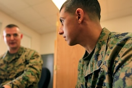 Sgt. Ricardo D. Torres, an aviation intermediate level structures mechanic with Headquarters and Headquarters Squadron here, listens to career advice given to him from Gunnery Sgt. Jeremy L. Hammock, a Manpower Management Support Branch–50 career counselor. Marines attending Sergeant's Course received one-on-one occupational guidance to improve their chances for promotion during a visit from MMSB–50 here Feb. 19 - 21.