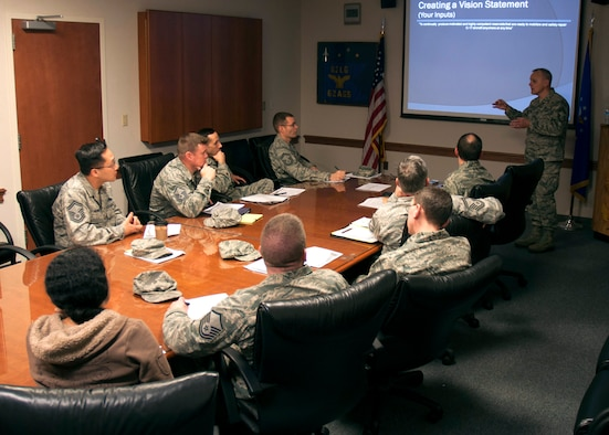 """Enlisted leaders from the 446th Aircraft Maintenance Squadron here, brainstorm on the proper mission and vision statements for the squadron, Jan. 29, 2013. """"For AMXS to provide a ready Reservist who will meet the mission requirements, we must always look forward, and determine ways of how we can improve ourselves,"""" he said. """"This will ultimately help us mitigate any future risks that could possibly prevent us from meeting those requirements."""" (U.S. Air Force photo/Master Sgt. Jake Chappelle)"""