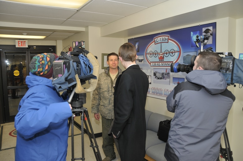 Maj Joshua Hicks, a pilot with the 109th Airlift Wing, New York Air National Guard, is interviewed by local media after flying an LC-130 aircraft from Antarctica back to New York.  The wing has just completed its 24th year supporting National Science Foundation operations throughout the continent of Antarctica.  (U.S. Air Force photo by MSgt. Willie Gizara/Released)