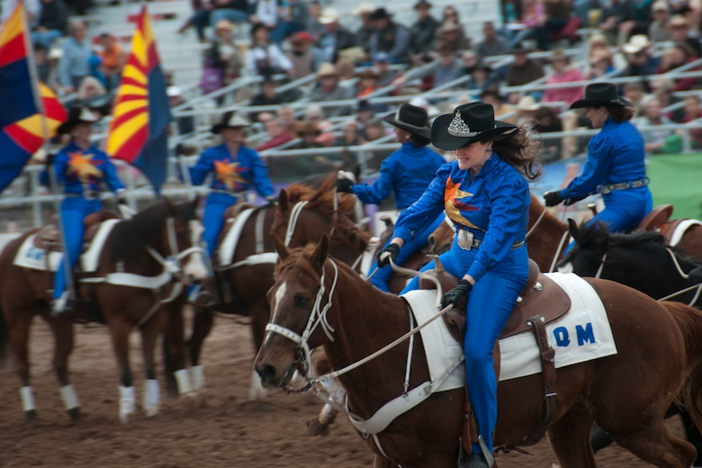 Tech. Sgt. Lacey Johnson, a member of the 162nd host aviation resource management office, was crowned Tucson Rodeo Attendent, a princess, for the 2001 Tucson Rodeo. This year Johnson is performing with the Quadrille de Mujeres, an equestrian drill team known for their speed and precision. (Photo provided by Tech. Sgt. Lacey Johnson)