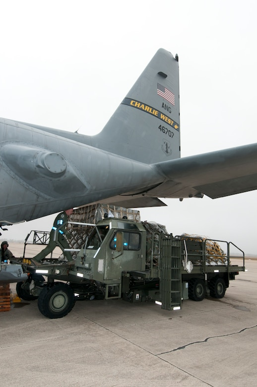 Staff Sgt. Steven Soblet of the 130th Airlift Wing Air National Guard, off-loads pallets from a C-130 Hercules, during Operational Readiness Exercise at the Mississippi Air National Guard's Combat Readiness Training Center Gulfport in Gulfport, Miss. The 134th AEW is comprised of four Units; the 153rd Airlift Wing, the 130th Airlift Wing, the 375th Air Mobility Wing and the 11th Wing. The exercise assesses the abilities of the individual units to deploy forces, quickly respond and recover assets during a weeklong exercise conducted and graded by an Exercise Evaluation Team. (U.S. Air Force Photo by Tech. Sgt. Bryan G. Stevens/Released)