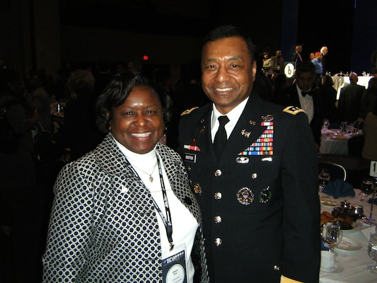 Lt. Gen. Thomas P. Bostick, chief of engineers, U.S. Army Corps of Engineers, congratulates Kimberly M. Spicer, Nashville District civil engineer and negotiator, on being named a modern day technology leader during the 27th Annual Black Engineer of the Year Award STEM Global Competitiveness Conference Feb. 8, 2013 in Washington D.C.