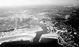 Aerial view of Kennebunk River. The Kennebunk River flows southeasterly along the border of Kennebunk and Kennebunkport, two popular summer resort communities on the coast of Maine, and empties into the Atlantic Ocean, about 30 miles southwest of Portland. Photograph taken  Dec. 1987.