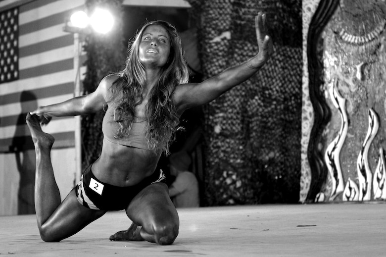 Capt. Michelle Ruehl, a member of the 455th Air Expeditionary Wing, participates in a bodybuilding competition at Bagram Airfield, Afghanistan, Feb. 16, 2013.  Ruehl, a first time competitor, placed second in the women's division. (U.S. Air Force photo/Senior Airman Chris Willis)