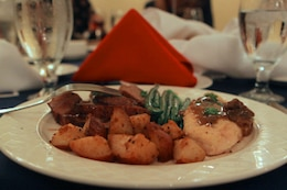The main course of the dinner included, tri-tip beef with horse radish cream sauce, chicken marsala, baby red roasted potatoes and fresh green beans during the 3rd annual Enlisted Recognition Dinner at the El Camino Country Club here Feb. 22.