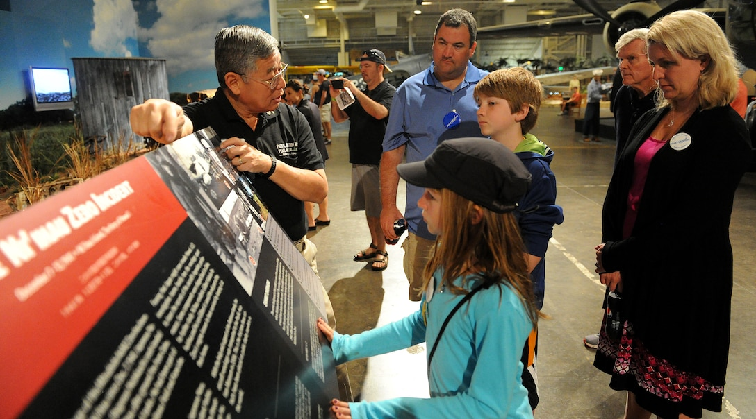 Ford Ebesugawa, tour guide (right), explains a Japanese Zero crash incident that occurred during the Dec. 7, 1941 Pearl Harbor attacks to Carl Hess, Make-A-Wish recipient (left), and his sister Kayelynn Hess (center) at the Pacific Aviation Museum, Ford Island, Hawaii, Feb. 19, 2013. Carl is fighting acute lymphoblastic leukemia (ALL), a fast-growing cancer of the white blood cells, and wished to be a downed World War II pilot. Since 1980, the MAW Foundation has changed the lives of children with life-threatening medical conditions through its wish-granting work. (U.S. Air Force photo/Tech. Sgt. Jerome S. Tayborn)