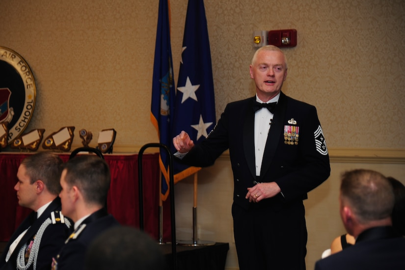 Chief Master Sgt. Richard Kaiser, Air Mobility Command command chief, speaks to Airmen Leadership School graduates and audience at the ALS graduation ceremony at the Charleston Club, Feb. 14, 2013, at Joint Base Charleston - Air Base, S.C. Kaiser and Gen. Paul Selva, AMC commander, were the guest speakers for the ceremony.