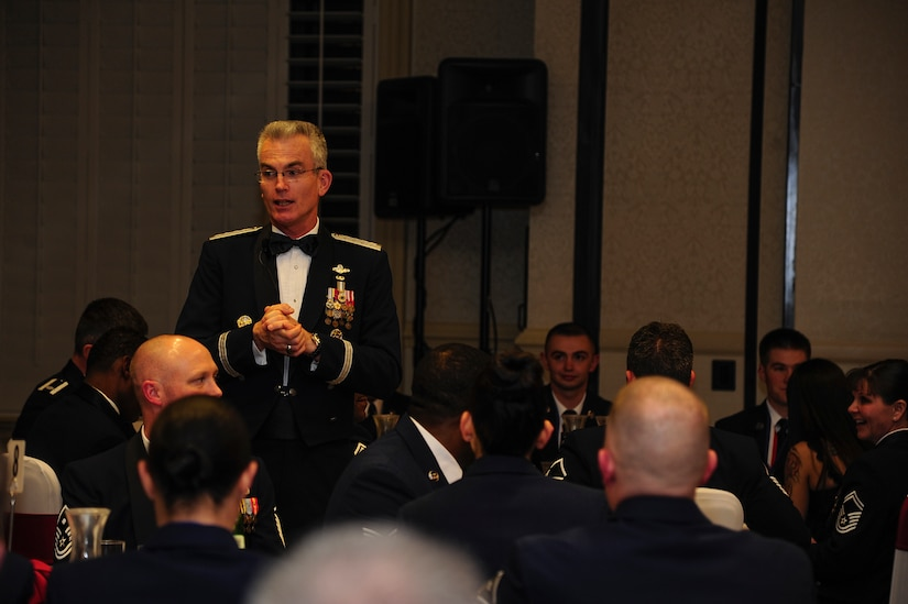 General Paul Selva, Air Mobility Command commander, speaks to Airmen Leadership graduates and audience at the ALS graduation ceremony at the Charleston Club, Feb. 14, 2013, at Joint Base Charleston - Air Base, S.C. Selva and Chief Master Sgt Richard  Kaiser, AMC command chief, were the guest speakers for the ceremony.