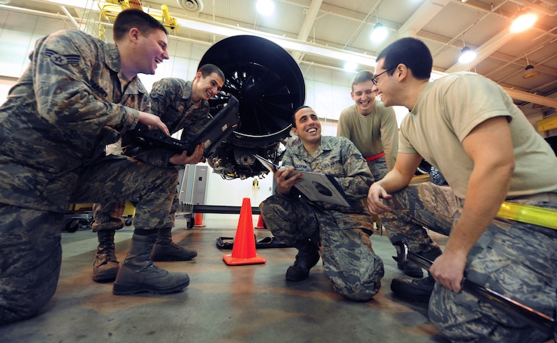WHITEMAN AIR FORCE BASE, Mo. -- Aerospace propulsion mechanics from the 509th Maintenance Squadron share a laugh while reviewing technical data, Feb. 13. Technical data gives maintainers an in- depth, step-by-step description of how tasks need to be performed. (U.S. Air Force photo/Staff Sgt. Nick Wilson) (Released)