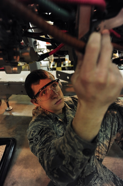 WHITEMAN AIR FORCE BASE, Mo. -- Airman 1st Class John Kincaid, 509th Maintenance Squadron aerospace propulsion apprentice, installs a cannon plug on a B-2 Spirit engine Feb. 13. The cannon plug is used by maintainers as a disconnect point for electrical cables. (U.S. Air Force photo/Staff Sgt. Nick Wilson) (Released)