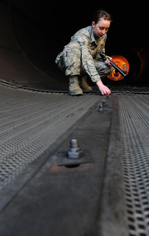 WHITEMAN AIR FORCE BASE, Mo. -- Senior Airman Kaitlyn Fawber, 509th Maintenance Squadron aerospace propulsion journeyman, inspects a test cell rivet, Feb. 13. The test cell is a $2.9-million-facility used by jet engine mechanics to test the serviceability of jet engines. (U.S. Air Force photo/Staff Sgt. Nick Wilson) (Released)