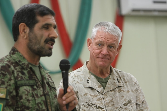 """Major Gen. Sayed Malook, 215th Corps commanding general and Maj. Gen. Charles M. Gurganus, II Marine Expeditionary Force (Forward) and Regional Command Southwest commanding general, share a laugh during the I MEF (Fwd) farewell dinner at the Afghan Cultural Center here, Feb. 24. Major Gen. Gurganus, in his farewell speech to distinguished coalition and Afghan officials which included the Nimroz province Governor Muhammad Sawar Sabet, said, """"There will certainly be challenges in the future, but it will take courage on behalf of all Afghans. During my last year, I've seen no shortage of courage."""" Major Gen. Gurganus will be replaced by Maj. Gen. W. Lee Miller, the II MEF (Fwd) commanding general, during the Regional Command Southwest Transfer of Authority, Feb. 27. (Official U.S. Marine Corps photo by Sgt. Bryan A. Peterson)"""