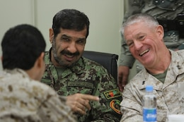 "Major Gen. Charles M. Gurganus, the I Marine Expeditionary Force (Forward) and Regional Command Southwest commanding general, speaks to distinguished coalition and Afghan officials during the I MEF (Fwd) farewell dinner at the Afghan Cultural Center here, Feb. 25. Major Gen. Gurganus, in his farewell speech, said as the coalition continues to advise Afghan National Security Forces, ""guns and bullets"" will become less important and education and economic development will be the key to Afghanistan's future. (Official U.S. Marine Corps photo by Sgt. Bryan A. Peterson)"