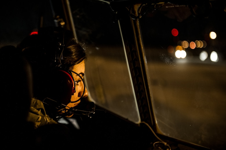 U.S. Air Force Senior Airman Nathalyn Lennon, a crew chief of the 4th Aircraft Maintenance Unit, stares out a cock-pit window of an AC-130U gunship while towing the aircraft to a new location on the flightline at Hurlburt Field, Fla., Feb. 20, 2013. One person has to work the brakes of the aircraft while another uses a vehicle to position the aircraft in its new location. (U.S. Air Force photo/Airman 1st Class Christopher Callaway)