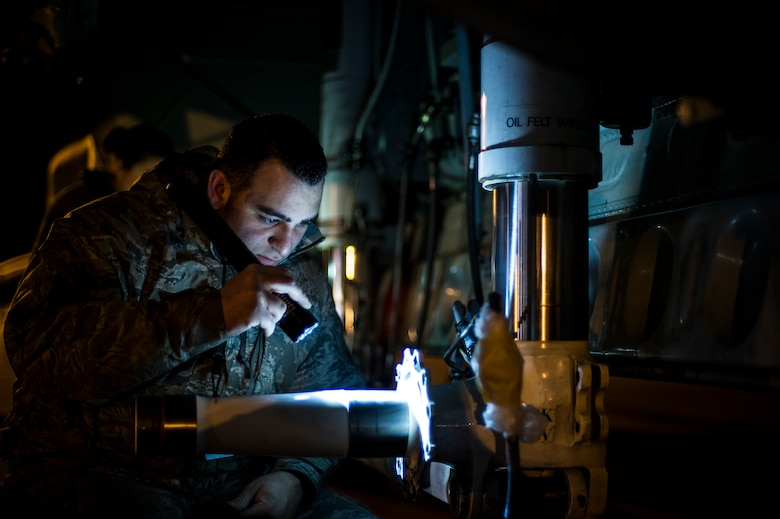 U.S. Air Force Senior Airman Fernando Kossler, a crew chief at the 4th Aircraft Maintenance Unit, inspects a brake hub before replacing the brakes on an AC-130U gunship at the flightline on Hurlburt Field, Fla., Feb. 20, 2013. Maintenance personnel consisting of crew chiefs with a complement of systems technicians, augmented by Airmen from the 1st Special Operations Component Maintenance Squadron and 1st Special Operations Equipment Maintenance Squadron, normally accompany deployed aircraft. (U.S. Air Force photo/Airman 1st Class Christopher Callaway)