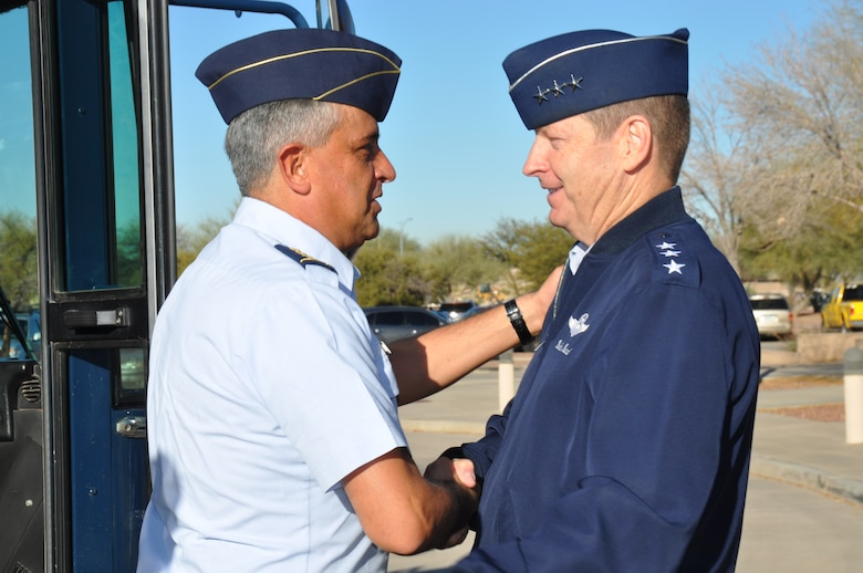 Gen. Tito Pinilla, Colombian Air Force Commander in Chief, greets Lt. Gen. Robin Rand, 12th Air Force (Air Forces Southern) commander at Davis-Monthan AFB, Ariz., Feb. 26. Gen. Pinilla is visiting AFSOUTH to attend the Latin American Interoperability Workshop, Feb. 26 -28. The objective of the workshop is to unite influential Air Force Chiefs in the U.S. Southern Command area of responsibility in developing strategies to counter transnational organized crime, build partnership capacity and plan for emergency situations such as humanitarian assistance and disaster relief efforts. (U.S. Air Force photo by Master Sgt. Kelly Ogden/Released).