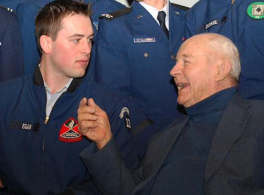 Retired Brig. Gen. Chuck Yeager, right, talks to Cadet 1st Class Henry Egan after a National Character and Leadership Symposium presentation at the Air Force Academy Feb. 22, 2013. Yeager was the first person to fly faster than the speed of sound, having made the historic flight Oct. 14, 1947. Egan is assigned to Cadet Squadron 23. (U.S. Air Force photo/Don Branum)