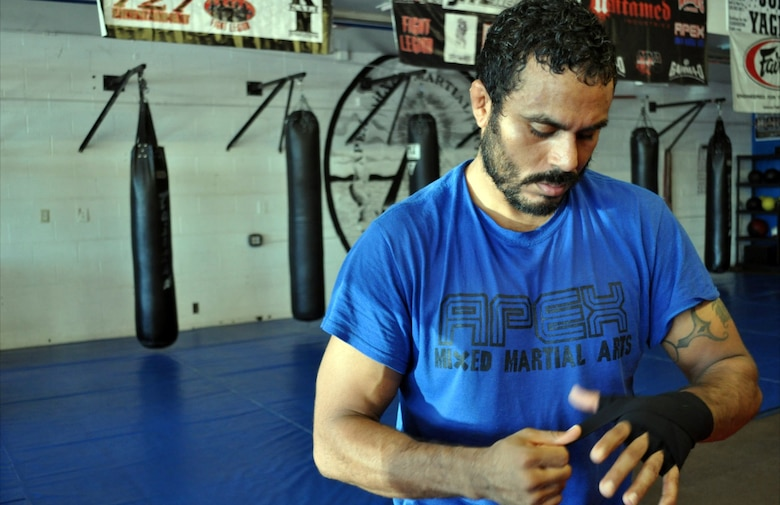 Tech. Sgt. Michael Parker prepares for an MMA training session at his gym of choice in Tucson, Apex Mixed  Martial Arts. (Courtesy photo)