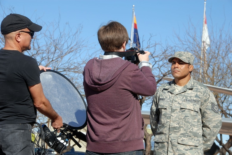 Local award-winning documentary artists Marcus De Leon and Brody Anderson capture images of Tech. Sgt. Michael Parker at the Tucson Air Guard Base during a recent Unit Training Assembly. (U.S. Air Force photo by Staff Sgt. Dina Farmer)