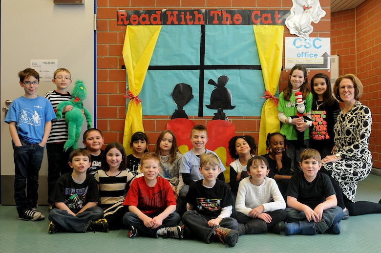 Collen Luckie's second-grade class poses for a group photo in front of their art display for Read Across America at Ramstein Elementary School on Ramstein Air Base, Germany, Feb. 25, 2012. Entering its 16th year, Read Across America is a national event, also held at overseas military installations, to educate children of all ages about the importance of reading. (U.S. Air Force photo/Airman 1st Class Holly Cook)
