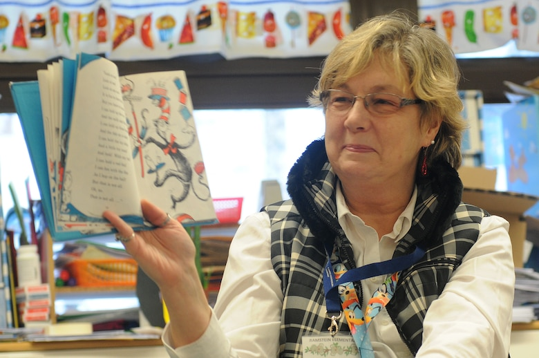 "Marianne Warwick reads ""The Cat in the Hat"" to her first-grade class as part of Read Across America week at Ramstein Elementary School on Ramstein Air Base, Germany, Feb. 25, 2012. Entering its 16th year, Read Across America is a national event, also held at overseas military installations, to educate children of all ages about the importance of reading. (U.S. Air Force photo/Airman 1st Class Holly Cook)"