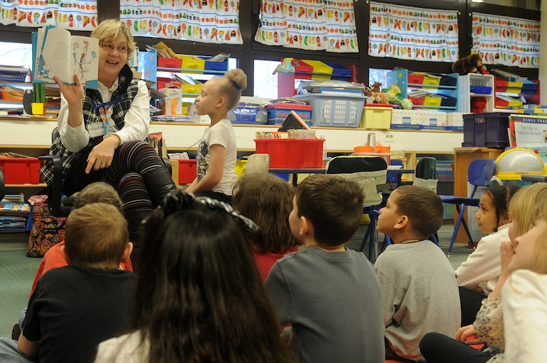 "Students of Marianne Warwick's first-grade class listen, as she reads ""The Cat in the Hat"" as part of Read Across America week at Ramstein Elementary School on Ramstein Air Base, Germany, Feb. 25, 2012. Entering its 16th year, Read Across America is a national event, also held at overseas military installations, to educate children of all ages about the importance of reading.(U.S. Air Force photo/Airman 1st Class Holly Cook)"