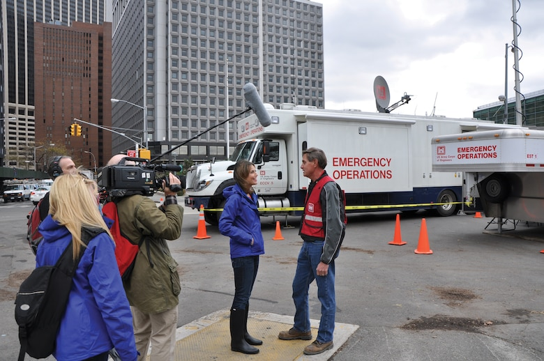 Roger Less, chief, Design Branch, is interviewed by Savannah Guthrie from NBC's TODAY show for an update on unwatering New York City's transporation tunnels . In the background is the Corps Deployable Tactical Operations System at Battery Park that served as the team's office.