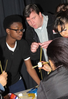 Huntsville Center Engineer Jason Page, advises his student team during a National Engineers Week activity at J.O. Johnson High School, Feb. 21.