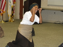 "Gwendolyn Brilley-Strand portrays ""Harriet Tubman: The Chosen One"" in her performance for federal employees at the City Crescent Building in Baltimore, Md., on Feb. 26, as part of the U.S. Army Corps of Engineers, Baltimore District, observance of African American Black History Month."
