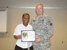 Col Trey Jordan, U.S. Army Corps of Engineers, Baltimore District commander, presents Ms. Gwendolyn Brilley-Strand a Certificate of Appreciation and a District Coin for her performance as Harriet Tubman.