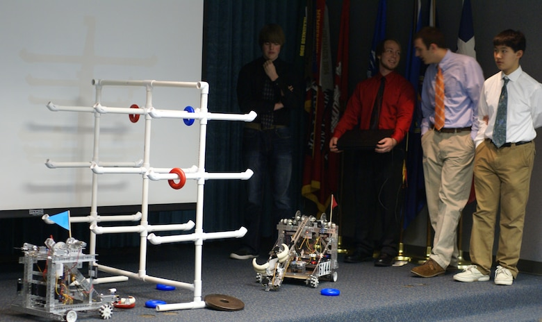 Team members from the Owasso Robotics program demonstrate their robot during the SAME meeting at the Tulsa District.