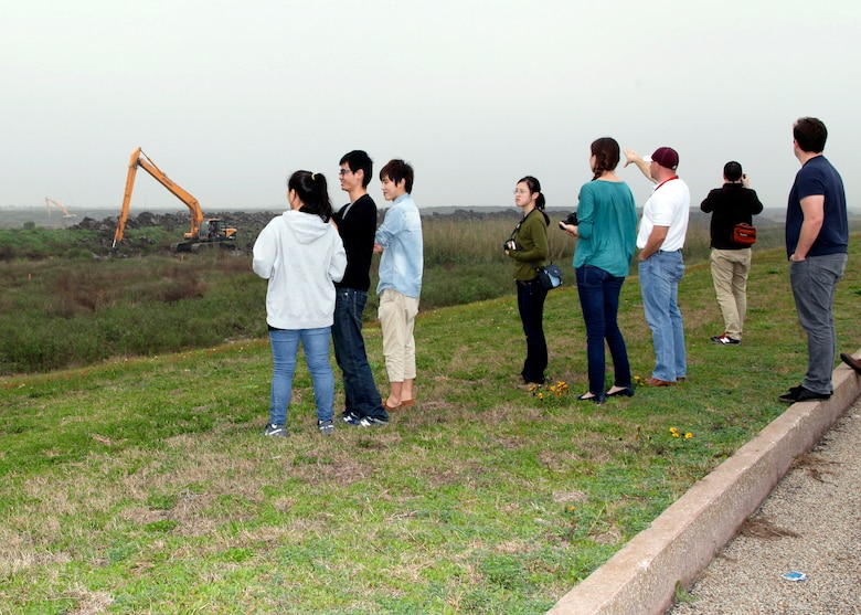 USACE Galveston District welcomes a group of visiting Louisiana State University students enrolled in the Robert Reich School of Landscape Architecture. The LSU students traveled to Galveston Feb. 21, 2013, to visit one of the district's beneficial use sites known as the Corps Woods, to get a better understanding of infrastructure sustainability issues, remediation and green infrastructure design in landscapes associated with maritime commerce such as the district's Beneficial Use Program.