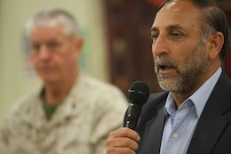 "Mohammad Sarwar Subat, the Nimroz province governor, speaks to distinguished coalition and Afghan officials from both Helmand and Nimroz provinces during the I Marine Expeditionary Force (Forward) farewell dinner at the Afghan Cultural Center here, Feb. 24. Sabet, the Nimroz province governor, whose province benefitted greatly this past year when U.S. and coalition forces handed over control to ANSF, said it's ""our time to stand up and take our country back."" Noting Afghanistan looks completely different today than it did 11 years ago, the governor vowed to continue, ""To fight the insurgency and provide freedom in his province."" (Official U.S. Marine Corps photo by Sgt. Bryan A. Peterson)"