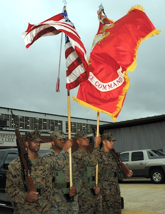 Marines with Marine Corps Logistics Command practice precision color guard movements recently in front of Marine Depot Maintenance Command.