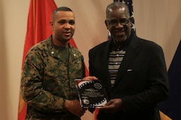 Lt. Col. David Everly, left, presented Willie Buchanon, right, with a plaque on behalf of the National Naval Officers Association's Camp Pendleton-Miramar Chapter and Naval Hospital Camp Pendleton for his participation as a guest speaker during the 2013 Black History Month program held at the naval hospital here, Feb. 26. Everly is the president of the NNOA chapter here and Buchanon is a retired NFL cornerback who played for the San Diego Chargers and grew up in Oceanside.