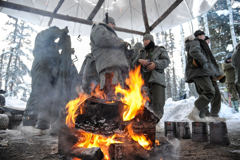 U.S. military members begin their first day of arctic survival training, also known as Cool School, after the morning briefing Feb. 20, 2013, Eielson Air Force Base, Alaska.  The training, conducted by Det. 1, 66th Training Squadron members, exposes students to the harsh extremes of Alaskan winters in a controlled learning evironment.  (U.S. Air Force Photo/Airman 1st Class Peter Reft)