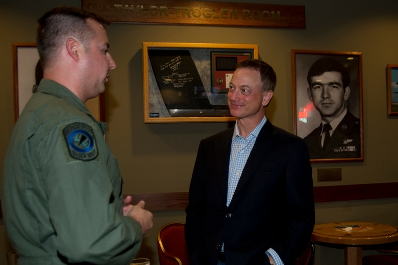 U.S. Air Force Tech. Sgt. Christofer Curtis, a CV-22 flight engineer of the 8th Special Operations Squadron, talks with Gary Sinise at the Hooch Bar and Grille at Hurlburt Field, Fla., Feb. 8, 2013. Curtis had previously met Sinise in the hospital while Curtis recovered from injuries sustained during a deployment. (U.S. Air Force photo by Airman 1st Class Naomi M. Griego)
