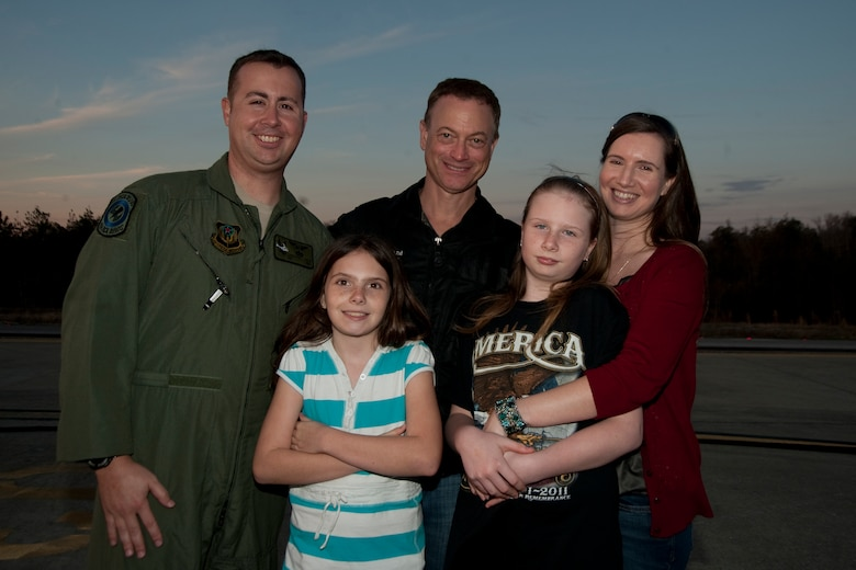 U.S. Air Force Tech. Sgt. Christofer Curtis, a CV-22 flight engineer of the 8th Special Operations Squadron, and his family meet Gary Sinise after the Lt. Dan Band performed a concert for Hurlburt Airmen, family and guests on the flight line at Hurlburt Field, Fla., Feb. 9, 2013. Curtis had previously met Sinise in the hospital while Curtis recovered from injuries sustained during a deployment. (U.S. Air Force photo by Airman 1st Class Naomi M. Griego)