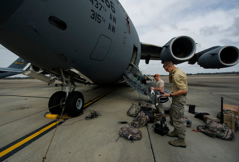 Airmen from the 437th Aircraft Maintenance Squadron check gear during a post-flight inspection Feb. 26, 2013, at Joint Base Charleston - Air Base, S.C. Members of the 437th AMXS inspect, service and maintain Globemaster III C-17A aircraft to enable them to perform assigned global airlift missions ranging from combat support operations and humanitarian relief to aeromedical evacuations. (U.S. Air Force photo/ Senior Airman George Goslin)