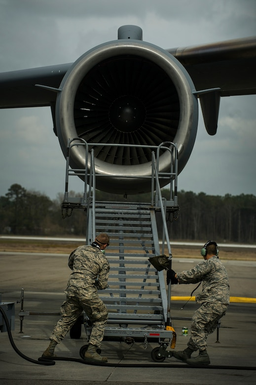Airman 1st Class Minh Pham and Airman Cory Parks, 437th Aircraft Maintenance Squadron crew chiefs, move a B-1 Stand into position during a post-flight inspection Feb. 26, 2013, at Joint Base Charleston - Air Base, S.C. Members of the 437th AMXS inspect, service and maintain C-17A aircraft to enable them to perform assigned global airlift missions ranging from combat support operations and humanitarian relief to aeromedical evacuations. (U.S. Air Force photo/ Senior Airman George Goslin)