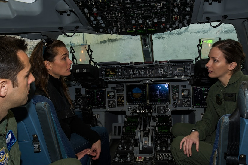 Captain Michael Busse and 1st Lt. Lauren Hoyt, 16th Airlift Squadron pilots, explain C-17 Globemaster III cockpit procedures to actress Brooke Shields Feb. 22, 2013, at Joint Base Charleston-Air Base, S.C. Shields was at JB Charleston preparing for her upcoming role on the TV series Army Wives. (U.S. Air Force photo/Staff Sgt. Rasheen Douglas