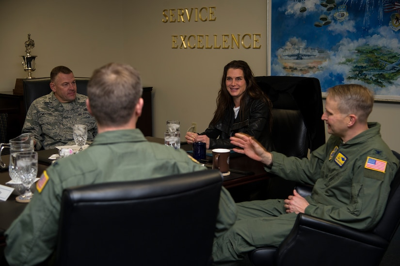 Colonel Richard McComb, 628th Air Base Wing commander (left), Col. Trevor Nitz, 437th Operations Group commander, and Col. Darren Hartford, 437th Airlift Wing commander (right), welcome actress Brooke Shields to Joint Base Charleston- Air Base, S.C., during her visit Feb. 22, 2013. Shields was at JB Charleston preparing for her upcoming role on the TV series Army Wives. (U.S. Air Force photo/Staff Sgt. Rasheen Douglas)