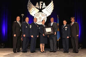 Accepting a diploma as the 400,000th Airman to receive a degree from the Community College of the Air Force is Senior Airman Emily Barchenger.  The Honorable Michael B. Donley, Secretary of the Air Force, presented the diploma and was joined by (R to L) AFA Central Florida Chapter President Michael Liquori, Community College of the Air Force Commandant Lt Col Jonathan T. Hamill, Chief Master Sergeant of the Air Force James A. Cody, Air Force Chief of Staff General Mark A. Welsh III, and Air Force Gala Chairman Tim Brock. (Courtesy photo)