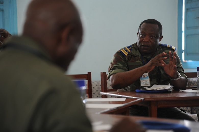 DOUALA, CAMEROON – Cameroon Air Force Col. Yamba Guillaume, C-130 pilot, and U.S. Air Force air advisors assigned to the 818th Mobility Support Advisory Squadron, Joint Base McGuire-Dix-Lakehurst, N.J., share ideas regarding aerial delivery systems at Douala Air Force Base, Douala, Cameroon, Feb. 21, 2013. Central Accord 2013 is a joint exercise in which U.S., Cameroon and neighboring Central African militaries partner to promote regional cooperation while and increasing aerial resupply and medical readiness capacity. (Photo by Master Sgt. Stan Parker, 621st CRW Public Affairs)