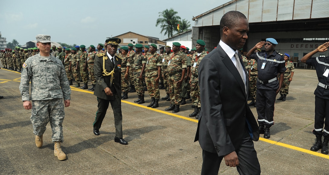 DOUALA, CAMEROON –  U.S. Army Brig. Gen. Peter Corey, U.S. Army Africa deputy commanding general and senior U.S. Army exercise official, is led by Joseph Beti Assomo, governor of the Littoral Region, as they conduct a pass in review exercise of participants during the opening ceremony for Central Accord 13, at Douala Air Force Base, Douala, Cameroon, Feb. 20, 2013. Central Accord 2013 is a joint exercise in which U.S., Cameroon and neighboring Central African militaries partner to promote regional cooperation while and increasing aerial resupply and medical readiness capacity. (Photo by Master Sgt. MSgt Stan Parker, 621st CRW Public Affairs)