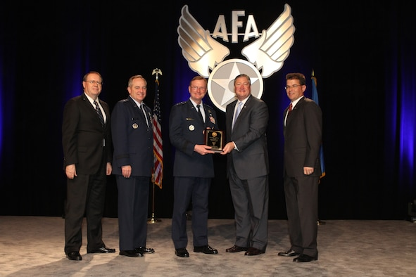 Secretary of the Air Force Michael B. Donley, along with Chief of Staff of the Air Force Gen. Mark A. Welsh III, AFA Central Florida Chapter President Michael Liquori and Air Force Gala Chairman Tim Brock, presents the Jimmy Doolittle Educational Fellow award to Air University Commander Lt. Gen. David S. Fadok. The award presentation was held during the Air Force Association Central Florida Chapter's Air Force Gala banquet in Orlando, Fla., Feb. 21. (Courtesy photo)