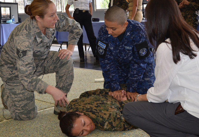 Staff Sgt. Autumn Clark gives step-by-step instructions to a member of the Salvadoran Air Force on the techniques to subdue and restrain a suspect, played here by a fellow classmate from the Salvadoran army. This instruction was part of a week long exchange of expertise in security and law enforcement between female members of the New Hampshire National Guard's security forces squadron and female members of the Salvadoran police and military from February 4th through 8th, 2013, at the Center for Military Education and Doctrine, San Salvador, El Salvador. (National Guard photo by 1st Lt. Alec Vargus/released)