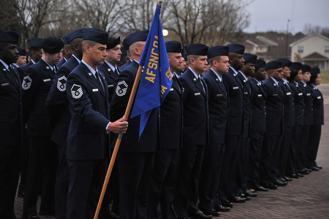 Airmen form as a flight during the reviele ceremony during the 40th anniversary of the Air Force Senior NCO Academy. As part of the Thomas N. Barnes Center for Enlisted Education, SNCOA is the gateway to the top of the enlisted ranks. Prior to being promoted to E-8, Airmen must complete this course, or a sister service equivalent. (U.S. Air Force photo by Airman 1st Class William Blankenship)