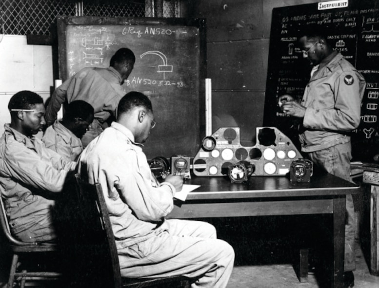 """Tuskegee Airmen"" personnel review the operations of various aircraft instruments in this photo taken sometime in 1943 or 1944 at what is now called Selfridge Air National Guard Base. During World War II, Selfridge served as one of several key training sites for the all-African American units that later came to be known as the Tuskegee Airmen. (Air Force file photo)"